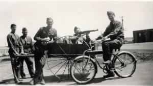 Guido on bike with army buddies.jpg