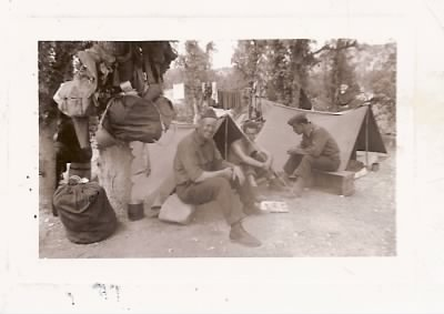 FH-FAMD-019u Norman Duncan Age 30 Seated Center -- Typical US Army Camp scene -- 10 Jun 1944.jpg