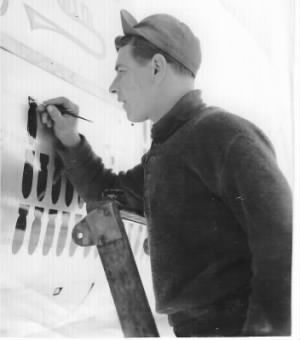 Fred painting the Mission Tally on the B-25 BOMBER