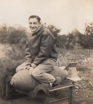 Lt Feinberg sitting on a 500 pound bomb