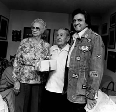 Johnny Cash with parents Ray & Carrie - Fold3.com