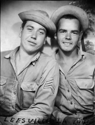 L-R:  Sgt. Rix Rutland and Sgt. Robert Evins clowning around in Louisiana during 10 day maneuver exercise - 1941.