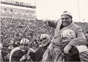 Lombardi is carried off the field by linebacker Dan Currie, center, and defensive tackle Dave Hanner.jpg
