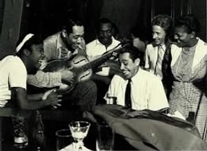 Sister Rosetta Tharpe on the left, Duke Ellington pretending to play Rosetta's resophonic guitar, and Cab Calloway at the piano..jpg